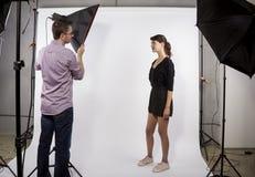 Photographer Demonstrating Studio Photography stock photo