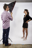Photographer Demonstrating Studio Photography stock images