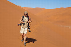 Photographer in the desert Royalty Free Stock Image
