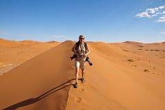 Photographer in the desert Stock Images