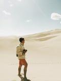 Photographer in desert Stock Image