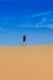 Photographer in desert Royalty Free Stock Photo