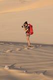 Photographer in desert Stock Photo