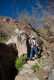 Photographer on desert trail stock photo