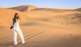 Photographer in the desert Royalty Free Stock Photos