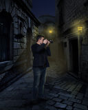 Photographer with digital camera in night alley. Photographer with digital camera taking picture in night alley Royalty Free Stock Photo