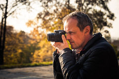 Photographer with digital camera outdoor Royalty Free Stock Photography