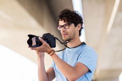 Photographer with digital camera shooting in city Stock Image
