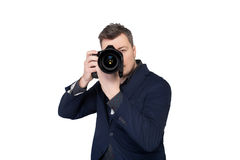 Photographer with digital camera taking picture Stock Image