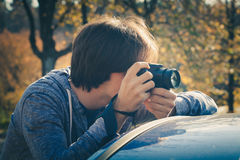 Photographer with digital camera Stock Photography