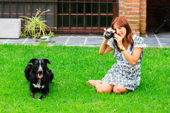 Photographer and dog. A photographer taking a picture of a dog Royalty Free Stock Images