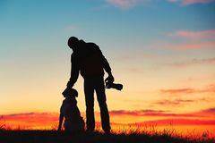 Photographer with dog Royalty Free Stock Photos