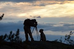Photographer and dog silhouettes Royalty Free Stock Photo
