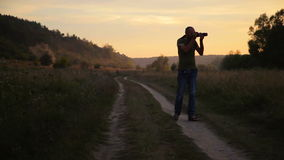 Photographer doing his job in the evening sun. stock video footage
