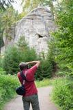 Photographer doing landscape photography Stock Photography