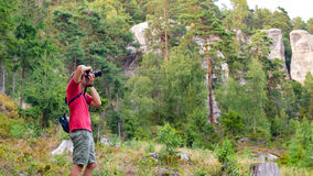 Photographer doing landscape photography Royalty Free Stock Photo