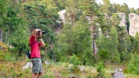 Photographer doing landscape photography Royalty Free Stock Photo