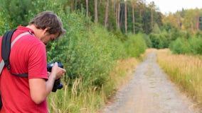 Photographer doing landscape photography Stock Images
