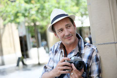 Photographer doing photo reportage in town Stock Photography