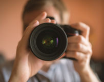 Photographer doing self portrait in a mirror. Royalty Free Stock Image