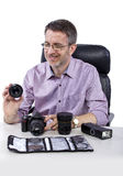 Photographer with Equipment. Professional photographer showing how to use camera gear.  He is showing his non branded equipment Royalty Free Stock Photography