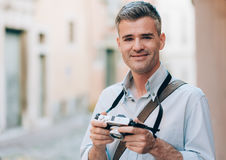 Photographer exploring a city Stock Image