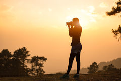 Photographer female taking a picture Stock Images