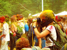 Photographer at the festival of paints HOLI in Moscow, 29.06.2014. People laughing at the festival of paints - one of the most colorful the Indian festival Royalty Free Stock Image