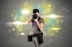 Photographer with flashing lights Royalty Free Stock Photo