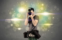 Photographer with flashing lights Royalty Free Stock Images