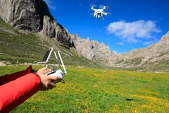 Photographer with flying drone. Outdoors Royalty Free Stock Image