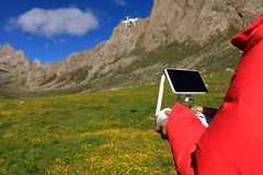 Photographer with flying drone. Outdoors Royalty Free Stock Images