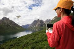 Photographer flying drone outdoors. Asian woman photographer flying drone outdoors Stock Images
