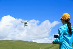 Photographer flying drone outdoors. Woman photographer flying drone outdoors Stock Photography