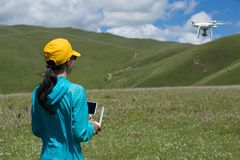 Photographer flying drone outdoors. Woman photographer flying drone outdoors Royalty Free Stock Images