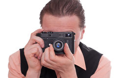 Photographer is focusing a rangefinder camera Stock Image
