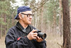 Photographer in a forest Royalty Free Stock Photography