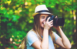 Photographer in the forest with a camera Royalty Free Stock Image