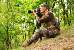 Photographer in the forest Royalty Free Stock Photo