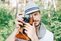 Photographer on a forest walk with a camera Royalty Free Stock Photography