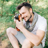 Photographer on a forest walk with a camera Royalty Free Stock Image