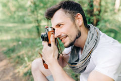 Photographer on a forest walk with a camera Stock Photography