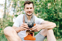 Photographer on a forest walk with a camera Royalty Free Stock Photo