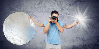 Photographer with four arms Royalty Free Stock Images