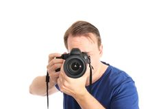 Photographer. Framing you with his full frame camera - isolated on white and retouched Stock Image