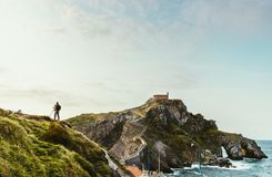 Photographer in front of Gaztelugatxe, Spain royalty free stock photography