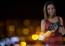 Photographer in front of lights bokeh. Digital composite of Photographer in front of lights bokeh Stock Image