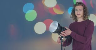 Photographer in front of lights. Digital composite of Photographer in front of lights Royalty Free Stock Photography