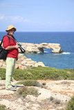 Photographer at Geropotamos Arch beach, Crete Stock Photo