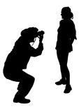Photographer and girl. Image of the photographer and model. Silhouettes on white background Royalty Free Stock Images